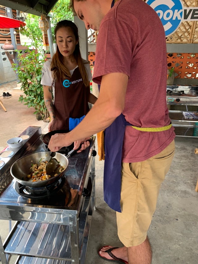 My boyfriend learning to cook Northern Thailand dishes at Cookventure.