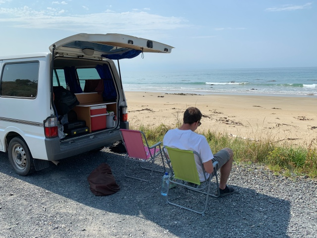 Stopping the camper van in New Zealand to take in the ocean view